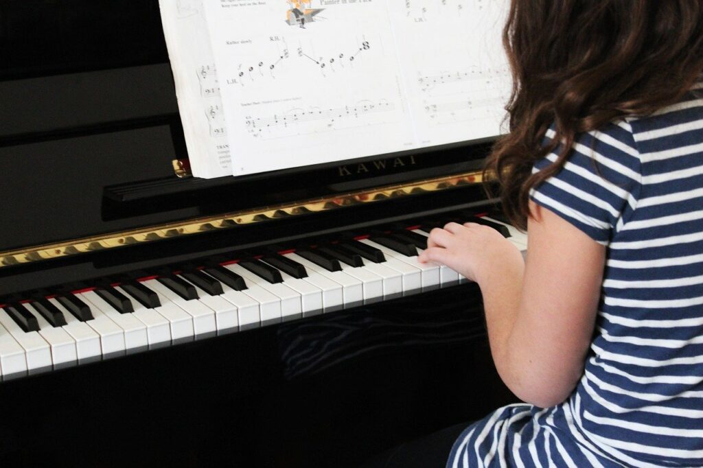 Regular Music and Piano Lessons benefit your children's development